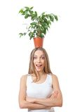 Smiling woman hold houseplant isolated on white. Royalty Free Stock Photos