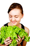 Smiling woman hold leaf lettuce Stock Image