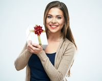 Smiling woman hold red gift box. Isolated white background. Studio Royalty Free Stock Photography