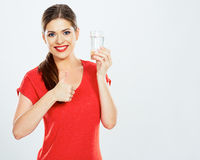 Smiling woman hold water glass . thumb up . Royalty Free Stock Photography