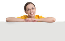 Smiling woman hold white blank paper board Royalty Free Stock Photo