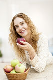 Smiling woman holding apple Royalty Free Stock Photos