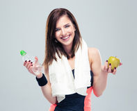 Smiling woman holding apple and bottle with water Royalty Free Stock Image