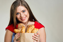 Smiling woman holding bag with bread. Stock Photos