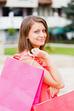 Smiling Woman Holding Bags Royalty Free Stock Images