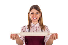Smiling woman holding a baking rolling pin Stock Image