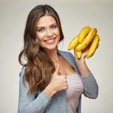 Smiling woman holding banana show thumb up. Yellow vitamins Stock Photography
