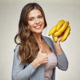 Smiling woman holding banana show thumb up. Yellow vitamins Royalty Free Stock Photography