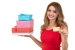 Smiling woman holding bank card and gift box isolated on a white background Royalty Free Stock Photos