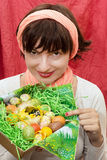 Smiling woman holding a basket with easter painted eggs Stock Images