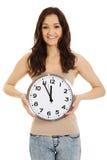 Smiling woman holding big clock. Stock Image
