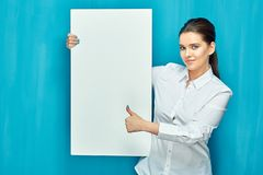 Smiling woman holding big white sign board show thumb up stock images