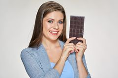 Smiling woman holding black chocolate. Isolated portrait Stock Photography