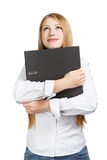 Smiling woman holding black folder with both hands Royalty Free Stock Photo