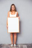 Smiling woman holding blank board Stock Image