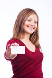 Smiling woman holding blank card. Studio shot of young caucasian smiling woman isolated on white background holding blank card Royalty Free Stock Photo