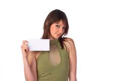 Smiling woman holding a blank card, isolated. Pretty smiling woman holding a blank note-card, isolated on white Royalty Free Stock Photography