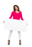Smiling Woman Holding Blank Poster Stock Photo