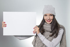 Smiling woman holding a blank sign Stock Images