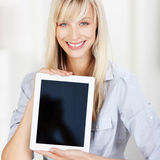 Smiling woman holding a blank tablet Stock Images