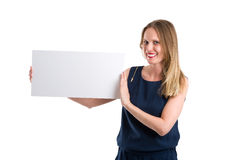 Smiling woman holding a blank white board to present something Stock Photo