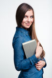 Smiling woman holding book and looking at camera Stock Image