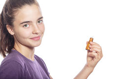 Smiling woman is holding a bottle of homeopathic medicine Stock Photo