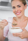Smiling woman holding bowl of cereal Stock Image