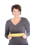 Smiling woman holding a brown envelope Royalty Free Stock Photos