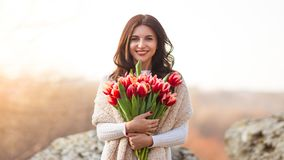Smiling woman with bunch of flowers stock photos