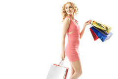 Smiling woman holding a bunch of shopping bags Stock Photos
