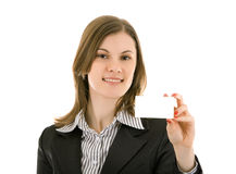 Smiling woman holding business card; isolated Royalty Free Stock Photography
