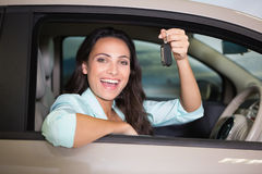 Smiling woman holding car key Stock Photography