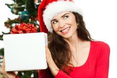 Smiling woman holding Christmas gift stock image