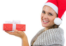 Smiling woman holding Christmas present Royalty Free Stock Images