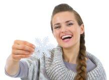Smiling woman holding Christmas snowflake Royalty Free Stock Photos