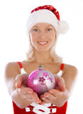 Smiling Woman Holding Christmas Toy Royalty Free Stock Photography