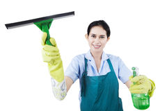 Smiling woman holding cleaner equipment Royalty Free Stock Images