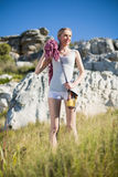 Smiling woman holding climbing equipment and looking up Royalty Free Stock Images