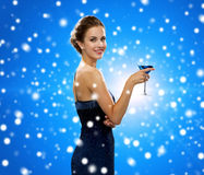 Smiling woman holding cocktail Stock Images