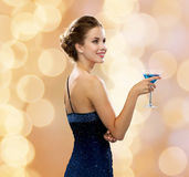 Smiling woman holding cocktail Stock Photography