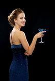 Smiling woman holding cocktail Stock Image