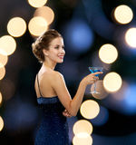 Smiling woman holding cocktail Royalty Free Stock Image