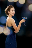 Smiling woman holding cocktail Stock Photos