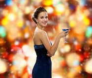Smiling woman holding cocktail Stock Photo