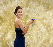 Smiling woman holding cocktail Royalty Free Stock Photography