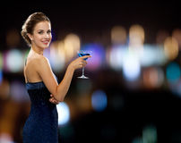 Smiling woman holding cocktail Royalty Free Stock Photo