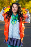Smiling woman holding color plastic penny board Stock Photography