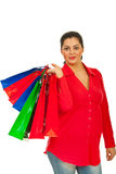 Smiling woman holding colorful bags Royalty Free Stock Image