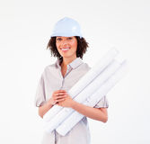 Smiling woman holding construction plans Royalty Free Stock Image
